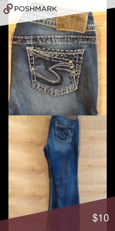 Sliver jeans. Size 27 Slim boot cut. Sliver brand. Size w-27 L-31 great condition. Close up picture reflects true color of denim. Rhinestones and studs on back and front pockets. Smoke free, Pet free home. I ship next business day cause nobody likes to wait on cool stuff 😘 sliver Jeans Boot Cut