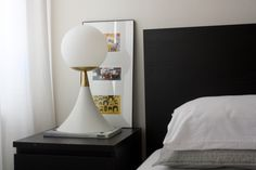 Our Saybrook table lamp was inspired by the arcing lines of American mid-century modern design.  This dimmable table lamp has a daring silhouette and tastefully mixed materials.  - Constructed of powder coated aluminum and solid unfinished brass  - Full-range dimmer switch on lamp base, making this