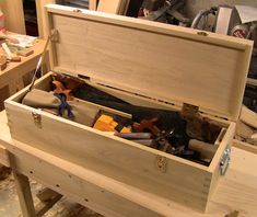 (Go back to part 1 )   After taking the box out of the clamps, I loaded it up with tools to check capacity and weight: 55 lbs. without lid. ...