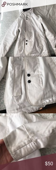 White Burton snowboarding coat This coat is very warm and great for snowboarding or in really snowy areas. It is from the brand Burton which sells very nice snowboarding jackets. This is a great coat however it does have stains on it. Minus the stains it's in great condition! Burton Jackets & Coats