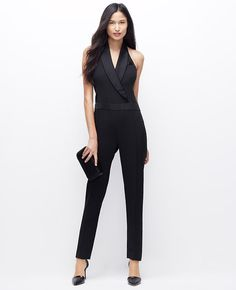 Midnight mix: a definitively modern marvel, our tuxedo jumpsuit makes any event black-tie worthy. V-neck with shawl collar and crossover front. Sleeveless.