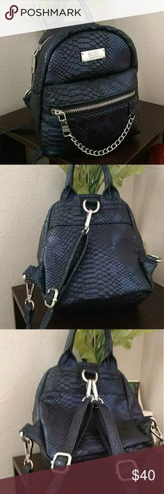 BCBG mini backpack Fashion backpack style purse Convertible and adjustable 2 straps Metallic dark blue Never used No tag Was a gift. Cute but not my style BCBG Bags