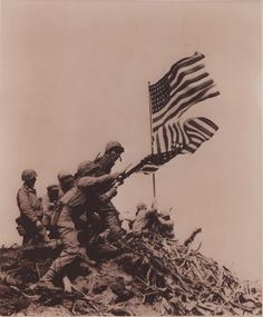 Flag Raising on Iwo Jima, 1945 by Marine Corps Archives & Special Collections, via Flickr. Lou Lowery's image of Marines replacing the first American flag atop Mount Suribachi with a second flag, made famous by Joe Rosenthal's iconic photograph.    From the collection of Lou Lowery (COLL/2575), Marine Corps Archives & Special Collections.
