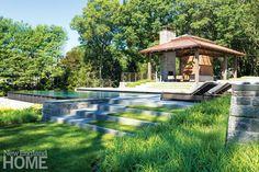 The pool, pool house, and Dan K. Gordon's award-winning landscape transformed a rocky slope.