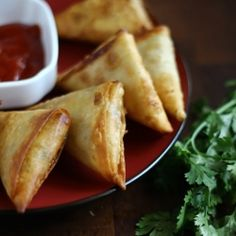 Samosas are a fried triangular pastry stuffed with mashed potatoes or curried beef.  Picture tutorial to get the perfect triangular shape.