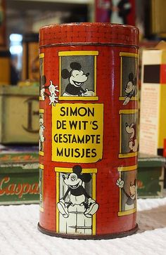 """Dutch bread toppings tin. - Muisjes (Dutch pronunciation: [ˈmœyʃəs]; translated little mice) are a traditional Dutch sandwich topping. While customary on bread, their most typical use is on beschuit, or rusk. Muisjes are made of aniseeds with a sugared and colored outer layer. Muisjes, meaning """"little mice"""" in Dutch, are named because the anise seed sprinkles are shaped like little mice, with the stem of the anise seed resembling a tail. They are made by one company only, De Ruijter."""