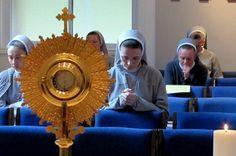 Nuns at prayer and adoration