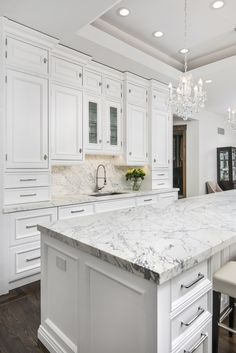 A renovated kitchen in a Victorian mansion in Chicago, IL with traditional detailing and modern design. All white kitchen. large kitchen island. #whitekitchen | Dresner Design: Kitchen design & custom cabinetry. #ModernKitchen #KitchenDesign #DresnerDesign #DesignInspiration www.dresnerdesign.com