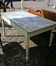 I love old farm tables.... They are even better with mismatched chairs and a bench.