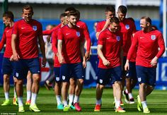 Kane, Lallana, Milner and Rooney pictured sharing a joke together as England's squad trained on Tuesday morning