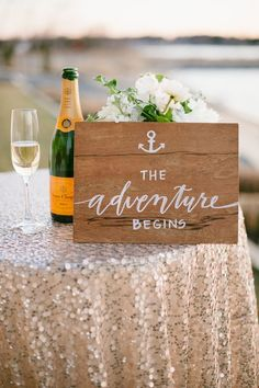 the adventure starts here sign and veuve clicquot champagne