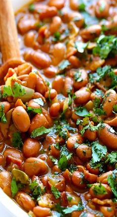 This drunken beans recipe (also known as frijoles borrachos) is simmered in beer, bacon and seasonings, and comes together in just 30 minutes! These drunken beans (frijoles borrochos) are simmered in bacon and beer, and ready to go in just 30 minutes! Drunken Beans, Good Food, Yummy Food, Comida Latina, Cooking Recipes, Healthy Recipes, Beer Food Recipes, Chorizo Recipes, Lunch Recipes