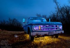 A grotty old Dodge truck made more attractive by the light of the moon and a flashlight with some theatrical lighting gels.