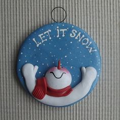 Ben is a 3 round hand sculpted polymer clay Christmas tree ornament. He is reaching up in to the snowy blue sky saying Let it snow There is enough room at the base to personalize this ornament if you so choose. This ornament is polymer and is not affected by heat or moisture. Send me a message with the name you request.