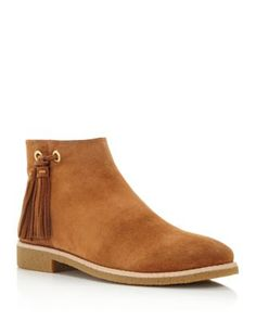 kate spade new york's tasseled booties kick it in a classic shape with just a touch of boho in touchably soft suede. | Sport suede upper, suede and leather lining, rubber sole | Imported | Fits true t