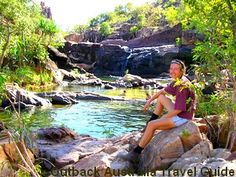 Sitting at the top of a waterfall in the Australian Outback.Travel Guide to the real outback