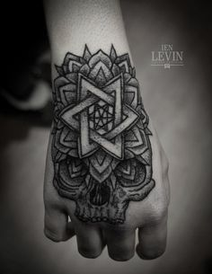 Skull and mandala hand tattoo by Ien Levin
