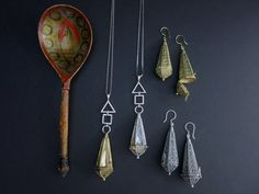 Amulet pendants and earrings in sterling silver and gold plated brass.