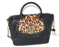 Emma Fox Leopard Leather Gold Chain Black Handbag Riding Equestrian Black /Leopard Cross Body Bag. Get the trendiest Cross Body Bag of the season! The Emma Fox Leopard Leather Gold Chain Black Handbag Riding Equestrian Black /Leopard Cross Body Bag is a top 10 member favorite on Tradesy. Save on yours before they are sold out!