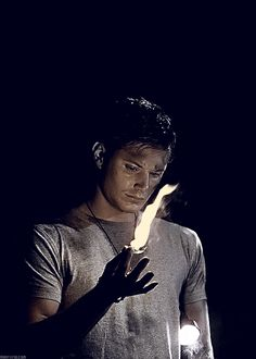 Character inspiration - someone probably handed him that flashlight he has tucked under his arm, and he responded with his own light. :) Though if he really wanted a light to substitute the flashlight he wouldn't have used his fire because their fire is never really bright.