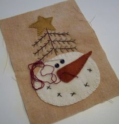 Wool applique -- verry cute - not sure why there is a tree growing out of the snowmans head but I like the tree