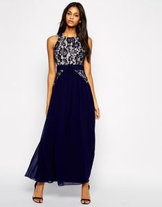 Maybe this dress? (Little Mistress Maxi Dress With Pleated Skirt)