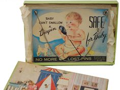 I'm giddy over this one!  Midcentury diaper pins connected by a chain.  I almost want to buy this...
