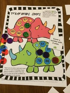 Place Value Games FREEBIES for 2 digit numbers. - Triceratops Spots Place Value Board Game - Players cover the spots on the Triceratops according to the clues on the cards.