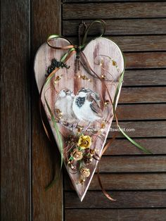 A hanging wooden shaped heart decorated with birds, beads and paper flowers can be a perfect gift for someone special or decorate a door, a window or corner of your room with the warm touch of wood. Below you can find full description of the project and link to the materials used. View a large …