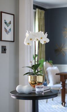 Creating entryway style with an orchid and a little bling.