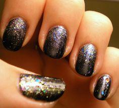 Black and rainbow glitter nails.