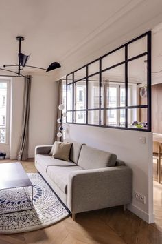 Appartement Paris : 80 masculins mais lumineux A living room separated by a glass roof Living Room Grey, Home Living Room, Living Room Decor, Home Room Design, Home Interior Design, Room Partition Designs, Separating Rooms, Apartment Interior, Bright Apartment
