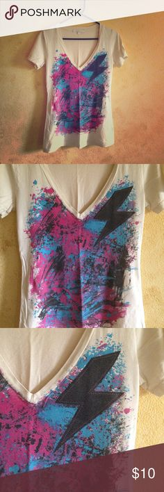 Lightning Graphic V-Neck Pretty cool casual top. Loved. 100% cotton. Very comfy. One small, teeny tiny hole on the back. Barely noticeable. This is a light tan color with blue, pink, black and a little bit of purple splatter and a black lightning bolt with fake pink stitching to make try and make it look like a patch. Super rad ⚡️💜💙🖤💗 Tops Tees - Short Sleeve