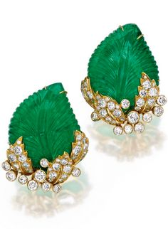 Pair of 18 Karat Gold, Emerald and Diamond Earclips of foliate design, the carved emerald leaves accented by round diamonds weighing approximately carats, signed MFC for Marilyn Cooperman. India Jewelry, Gems Jewelry, Gemstone Jewelry, Jewelery, Fine Jewelry, Emerald Earrings, Emerald Jewelry, Diamond Jewelry, Emerald Diamond