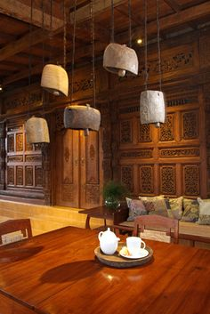 Javanese Reclaimed Wooden House - asian - porch - other metro - Iwan Sastrawiguna Interior Design.  Beautiful Indonesian furniture & architectural pieces!