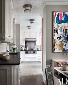 The kitchen's cooktop and hood are by Wolf. - Ali Wentworth and George Stephanopoulos's New York Apartment by Michael S. Celebrity Kitchens, Celebrity Houses, Celebrity Style, Architectural Digest, Beautiful Kitchens, Cool Kitchens, White Kitchens, Home Decor Kitchen, Kitchen Ideas