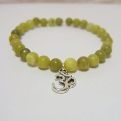 Olive New JADE Gemstone Bracelet ~ 6 to 8mm Jade beads & Silver OM charm - measures approx 7 inches www.sgtpepperscreations.etsy.com #sgtpepperscreations #handmadejewelry #etsy