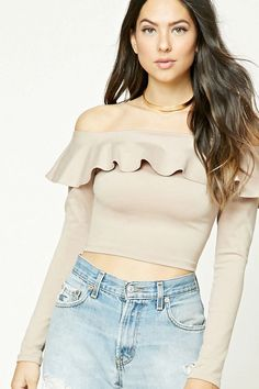 A knit crop top featuring an off-the-shoulder neckline, a flounce layer, and long sleeves.