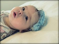 "Project Idea""  (They are decorating the baby again!) from mama says sew: Vintage Rosette Headband for Baby."