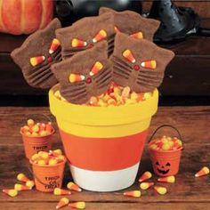 How to Make a Candy Corn Clay Pot...I have done this before and it turns out to be really, really cute, especially if you do the really little pots, cute party favors!