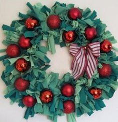 Upcycled Holiday Tee Shirt Wreath tutorial by Cathie Filian for Domestic in the City. Learn how to make Christmas wreaths from old t-shirts.