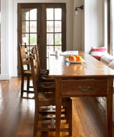 stained door white trim - love this long multipurpose table! - gorgeous French doors