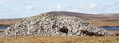 Barpa Langais;  a CHAMBERED CAIRN on the Isle of North Uist in the Outer Hebrides, Scotland.  It measures about 72 feet in diameter by 16 feet in height, and it is attributable to the Neolithic age. The roof is constructed of two massive slabs with a third slab superimposed.  The entrance is at the east side. Although the structure has partially collapsed, it is still possible to enter one chamber;  by bcoakley, via Flickr   info from ...