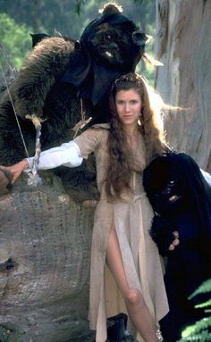 """Carrie Fisher as Princess Leia with some fellow """"Star Wars"""" characters on the planet Hoth"""