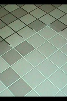 Green Grout Cleaner 7 cups water, 1/2 cup baking soda, 1/3 cup lemon juice, 1/4 cup vinegar- throw in a spray bottle, spray on floor, let sit for a few minutes...scrub!