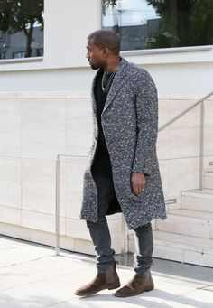Kanye West wearing Grey Overcoat, Black Crew-neck T-shirt, Grey Skinny Jeans, Dark Brown Suede Chelsea Boots Chelsea Boots Outfit, Chelsea Boots Style, Kanye West Style, Brown Suede Chelsea Boots, Grey Overcoat, Best Boots For Men, Botas Chelsea, Mens Boots Fashion, Stylish Clothes