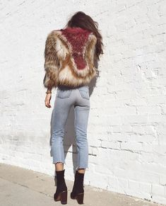 light coloured jeans and a faux fur cropped jacket