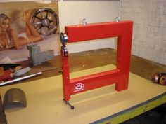 Your Dad once said he always wanted an English Wheel, but they're too expensive: this link shows several homemade metal shop tools, including small English Wheels.