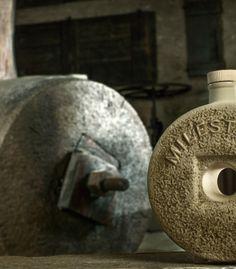 The actual millstone next to our Milestone Bottle.