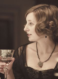 Downton Abbey - Lady Edith.  I love the little bit of lace peeping up from her dress.